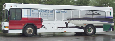 An Amtran bus with Life Comes at your fast bus wrap