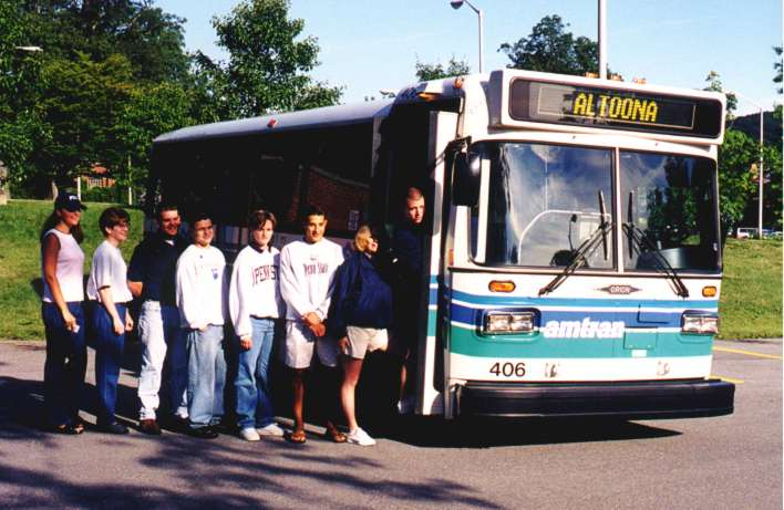 Students boarding AMTRAN bus